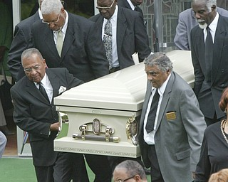 Pallbearers carry the casket of Edna Pincham from Third Baptist Church in Youngstown following Wednesday funeral services.