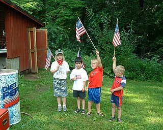 Danielle, Mario and Aniello Buzzacco of Canfield and Dominic Joseph of Youngstown (second from left) are marching their colors at their Papa's annual Fourth of July party in 2003.