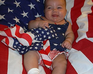 Olivia Carfolo was just 4 months old when this picture was taken July 4, 2003, at her grandparents' cottage in Conneaut Lake Park, Conneaut, Pa
