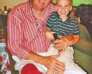 William Simons of Boardman and his grandson, Carter Simons of Youngstown, share Fourth of July birthdays. Carter, 4, is a son of Jason and Cathy Simons of Youngstown.