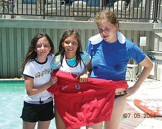 Katin Angelo, right, of Canfield and her cousins, Hannah and Ashley Angelo of Massillon, were required to wear red, white and blue during a family scavenger hunt while on vacation at Hilton Head Island in 2006.