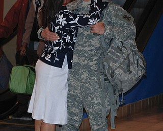 Christopher D. Lawson of San Diego, Calif., is greeted by his wife, Justine, formerly of Campbell, as he safely returned from Afghanistan a year ago. Their nephew, Brandon Suverison of Boardman, captured the moment at Pittsburgh International Airport.