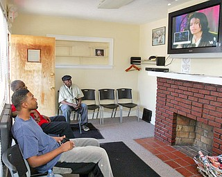 Watching TV coverage of Michael Jackson' funeral while waiting for haircuts at Legends Barbershop in Youngstown are from left are: Vincent Thomas, Kenneth McIntosh and James King, all of Youngstown.