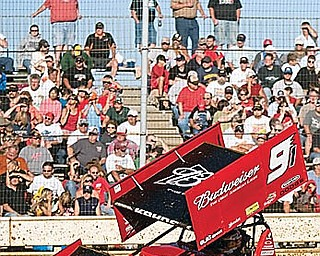 Kasey Kahne races past bleachers full of fans during an early heat race at Sharon Speedway on Tuesday evening.