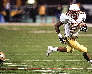 Braylon Heard breaks away from Harding's Desmond Reed (9) as Braylon heads for the endzone during first half action as Mooney shut out Harding in Warren 17-0 in 2008.