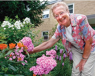 Sister Mary Ann, 90, has transformed the gardens with her green thumb - and proudly talks about her flowers plants and trees like family.