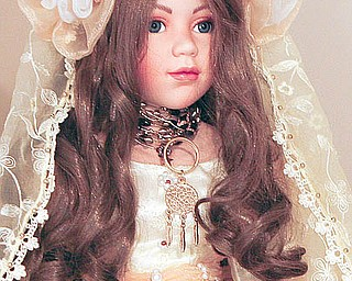 An indian doll - part of Stella Camuso has an entire room that houses her extensive bride-doll collection, as well as framed wedding stories. - robertkyosay