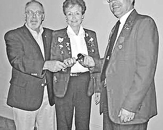 Special to The Vindicator PASSING MOMENT: A highlight of the joint Austintown Lions and Lioness installation ceremony was the moment when David Gauch, installing officer, at left, presented a gavel to Lioness president Lori Stone and Lions president Jack Kochansky.
