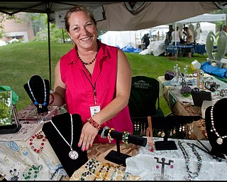 """7.11.2009Kim Mizerak, of Madison OH, displays her wares at her booth catering """"A Vintage Advantage Jewelry"""" on YSU's campus during the YSU Festival of the Arts on Saturday afternoon.Geoffrey Hauschild"""