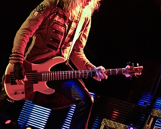 Rick Savage of Def Leppard performs live at Post Gazette Pavilion in Burgettstown, PA. The venue included Cheap Trick and Poison, Friday, July 10, 2009  Lisa-Ann Ishihara
