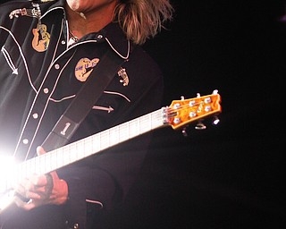 C.C. DeVille  of Poison performs live at Post Gazette Pavilion in Burgettstown, PA. The venue opened with Cheap Trick and headlined Def Leppard, Friday, July 10, 2009  Lisa-Ann Ishihara