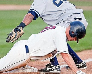 The Scrappers' Jordan Henry arrives safely at third base beating the throw to Staten Island Yankee Kelvin Castro during the bottom of the sixth inning at Eastwood Field on Wednesday evening.