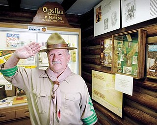 Bill Moss, dressed as Robert Baden-Powell, the founder of the Boy Scouts, poses for a portrait in his museum of Boy Scout memorabilia that was recently completed at Camp Stambaugh.