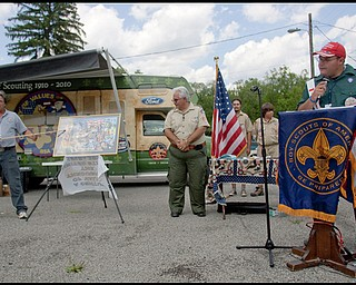 """7.16.2009 Tony Jones, of Michigan, introduces scouts at Camp Stambaugh on Thursday afternoon, to those who appear on the 100 year commemorative mural, """"A Century of Values,"""" traveling to all Scout Camps across the country. Geoffrey Hauschild"""