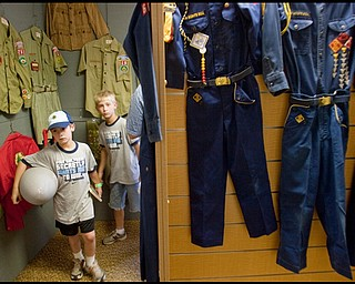 7.16.2009 Ben and Ethan Palo, ages 8 & 9 and members of Cub Scout Pack 220 in Lordstown, wander through an exhibit of past Scouting uniforms while visiting Camp Stambaugh on Thursday afternoon. Geoffrey Hauschild