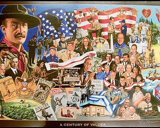 7.16.2009 Scouts are introduced to the 100 year commemorative mural traveling to all Scout Camps across the country while at Camp Stambaugh on Thursday afternoon. Geoffrey Hauschild