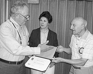 Special to The Vindicator SAYING THANKS: At their July 14 meeting, members of Struthers Rotary Club honored Bill DeCicco with a Paul Harris Fellow for his service to the community, including 15 years with the Rotary Club and 30 years as director of CASTLO. Carol DeCicco looks on as her husband, at left, accepts the award from Rotarian Paul Paris.