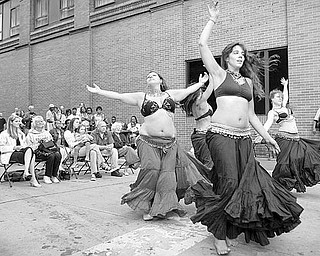 """Dancers of Eos, Megan Thomas, Jennifer Neil, Katie Makita and Robyn DePaul perform a Romany American Tribal Style belly dance to """"Yellow Rose Percussion"""" by Mezdeke during the Pig Iron Street Festival on Saturday afternoon."""