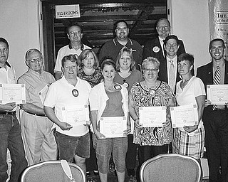 Special to The Vindicator ATTENDANCE AWARDS: At the end of the fourth quarter on July 1 the Rotary Club of Austintown recognized a number of members who achieved perfect attendance. Receiving attendance awards certificates were, from left, first row, Brian Frederic, Tony Cebrial, Karl Rein, Deanna Spirko, Robin Stock, Hillary Prestridge and Brian Laraway; second row, Susan Leetch, Melissa Crowley, and Dr. Mitch Dalvin; and third row, Ron Carroll, Dr. Mike Cafaro and Chuck Baker. Other perfect attendance members, not pictured, are Dave Buttar, Beverly Flowers, Leanna Mathes, Brian Pretoka and Gary Reel.