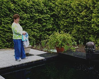 Elizabeth DeAngelo takes in the statue. She's been a Gardens guest for years but just recently discovered the fountain.