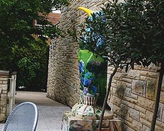 The fountain area is part of Beecher Terrace and shares space with the Gardens' painted penguin.
