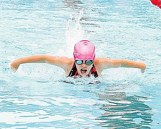Lindy Allen takes a breath during the swim meet at The Canfield Swim and Tennis Club.