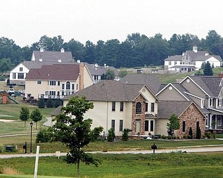 These homes in the Firestone Farms development in Columbiana County are not being foreclosed upon, but National City Bank has filed foreclosure action against Meadowbrooke Development.