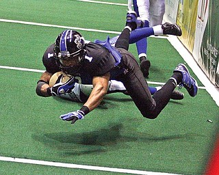 Quorey Payne of the Mahoning Valley Thunder flies through the air after breaking a tackle during their June 19 game against the Manchester Wolves at the Covelli Centre in Youngstown.