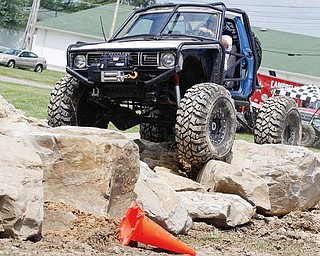 Terry Cunningham of Enon Valley, Pa. participates in the Rock Crawl for the Truck and Jeep Fest at Canfield Fairgrounds, Saturday July 25, 2009.