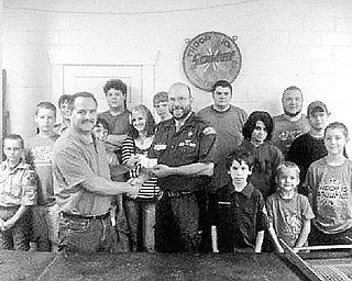 Special to The Vindicator REAL WINNERS: Struthers Rotary Club had its third annual Duck Race as a fundraiser on July 11 at Yellow Creek Park. Members of Boy Scout Troop 101, who assisted with and participated in the event, watch as Struthers Rotarian Bryan Higgins, at left, presents proceeds from the event, a check for $1,000, to Jeff Wormley, Scout Master of Boy Scout Troop 101. Proceeds from the event will help Struthers Boy Scouts/Venture Crew offset costs for summer camp and purchase much-needed equipment for their troop.