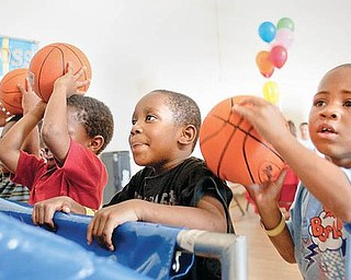 AIMING HIGH: Terrell Vaughn and Kendail Clark, both 4 and preschoolers at the Center for Community Empowerment, show their basketball skills. The weekend reunion for current and former residents of Rockford Village, formerly Kimmel Brook, will be filled with a list of activities for adults and children.