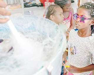 COTTON CANDY: KeyAsia Thompson eyes the cotton candy being spun during the weekend reunion at Rockford Village, formerly called Kimmel Brook. The idea started as a 10-year celebration for the Center for Community Empowerment but quickly grew to include an overall Kimmel Brook celebration.