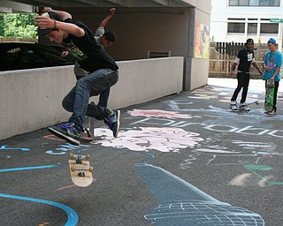 Skateboarders take advantage of David Grohl Alley in Warren.