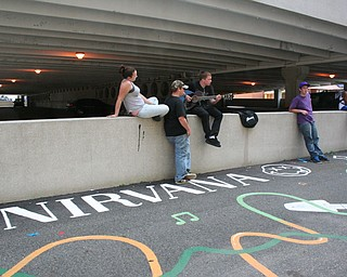 People hanging out at David Grohl Alley in Warren.