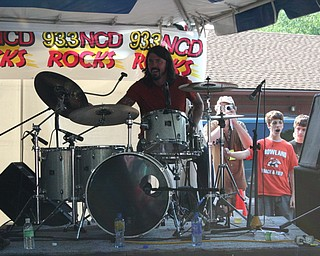 Dave Grohl performs with local band Love Turns Hate at the David Grohl Alley dedication ceremony in Warren.