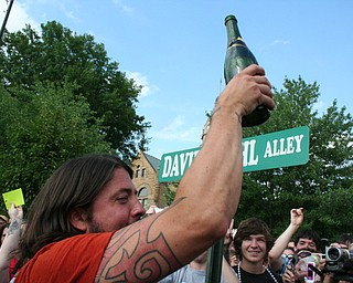 Dave Grohl celebrates with champagne at the David Grohl Alley dedication ceremony in Warren.