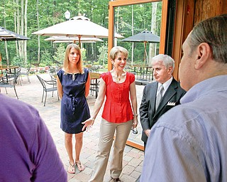 TAKING A LOOK: Dana, Mary and Tony Lariccia check out the Boardman Park Larricia Family Community Center with Paul Mastriana. The Larricia's were the first to donate money to the park campaign. Tony Lariccia said he thinks the center is a beautiful thing to have in Boardman Park.