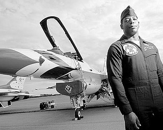 LEAD PILOT: Major Tyrone Douglas, originally from Kansas City, Mo., is the lead solo pilot in the Air Force Thunderbirds exhibition team. He stands in front of the F-16 he'll fly in this weekend's air show at the Vienna Air Base. More than 80,000 spectators are expected at the two-day event.