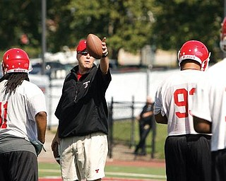 Coach Heacock talks to the team as they set up drills on the first day of practice at YSU.