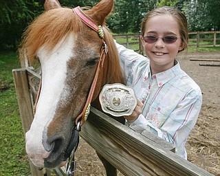 Madelynn Felgar with her Championship trophy  belt buckle  - robertkyosay