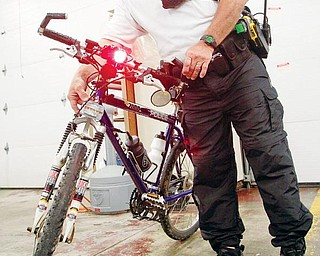 Sgt. Ken Goist of the New Middletown Police Department is the only member of the bike patrol.