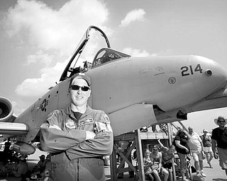 John O'Brien, an alumni of Cardinal Mooney, stands before his A-10 Warthog as a member of the 103 Fighter Squadron from the Willow Grove Naval Air Reserve Station in Philadelphia PA, during the Thunder Over the Valley Air Show on Sunday afternoon.