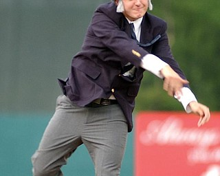 Phil Eckenrode, of Mineral Ridge, Ohio, throws out the first pitch prior to the Mahoning Valley Scrappers game against the Jamestown Jammers, Wednesday, Aug.14, 2002, in Niles, Ohio. Eckenrode was dressed up as James Traficant. The Single-A affiliate of the Cleveland Indians made August 14 ``Jim Traficant Night,'' and hairpiece wearers and sons of truck drivers got in free.  The former Ohio congressman, serving an eight-year prison sentence for bribery and racketeering, often calls himself ``the son of a truck driver.''