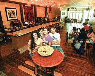 CREATIVE COLLECTIVE: From left, Natalia Lepore-Hagan, co-owner Jacob Harver, Courtney Waskin, and co-owner Keith Povec inside the new Lemon Grove.