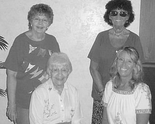 Special to The Vindicator OFFICIAL: During a reorganizational meeting at Enzo's Restaurant, new officers of Trumbull County Federation of Woman's Club were officially welcomed. Assuming their duties were, from left, seated, Sally Bidlack, treasurer, and Hatti Hawkins, president, and, standing, Eddie Wolcott, past president and trustee, and Shelby McElravy, vice president. On the agenda was a discussion of scholarships to be presented this year. The next meeting was planned for Oct. 20.