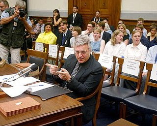 Empty chairs for members of Congress and prospective witnesses are seen behind Rep. James Traficant, D-Ohio, on Capitol Hill in Washington, Monday, July 15, 2002 prior to a House Ethics Committee hearing. Traficant told a House ethics panel considering whether he should be expelled from the House that he was innocent of the fraud, bribery and tax evasion that a jury convicted him of, and that he is being persecuted by the Justice Department.