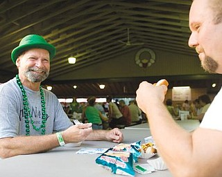 IRISH CLANS: Robert Oliver, left, and Chip Lutton, both of Youngstown, chow down on some shepherd's pie during the annual Gathering of the Irish Clans at St. Maron's Pavilion and Recreation Area on Meridian Road in Youngstown. The two-day event began Saturday.