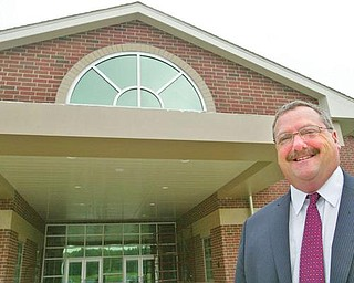 IN CHARGE: Kirk Baker, Jackson-Milton superintendent, near the entrance of the new facility.