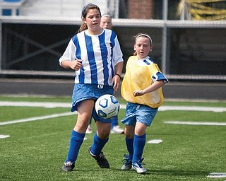 The Vindicator/Geoffrey HauschildGenna Cramp and Gina Cooper watch as the soccer ball bounces in front of them during a game at Poland High School.8.15.2009