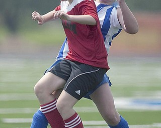 The Vindicator/Geoffrey HauschildPoland U14's Miranda Easterbrooke, 13, (right) steals the ball from Salem's Madison Schwartz, 13, (front) during a game at Poland High School.8.15.2009
